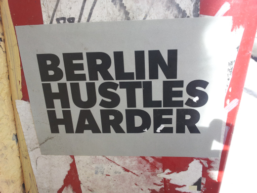 Slogan on a sign: Berlin hustles harder