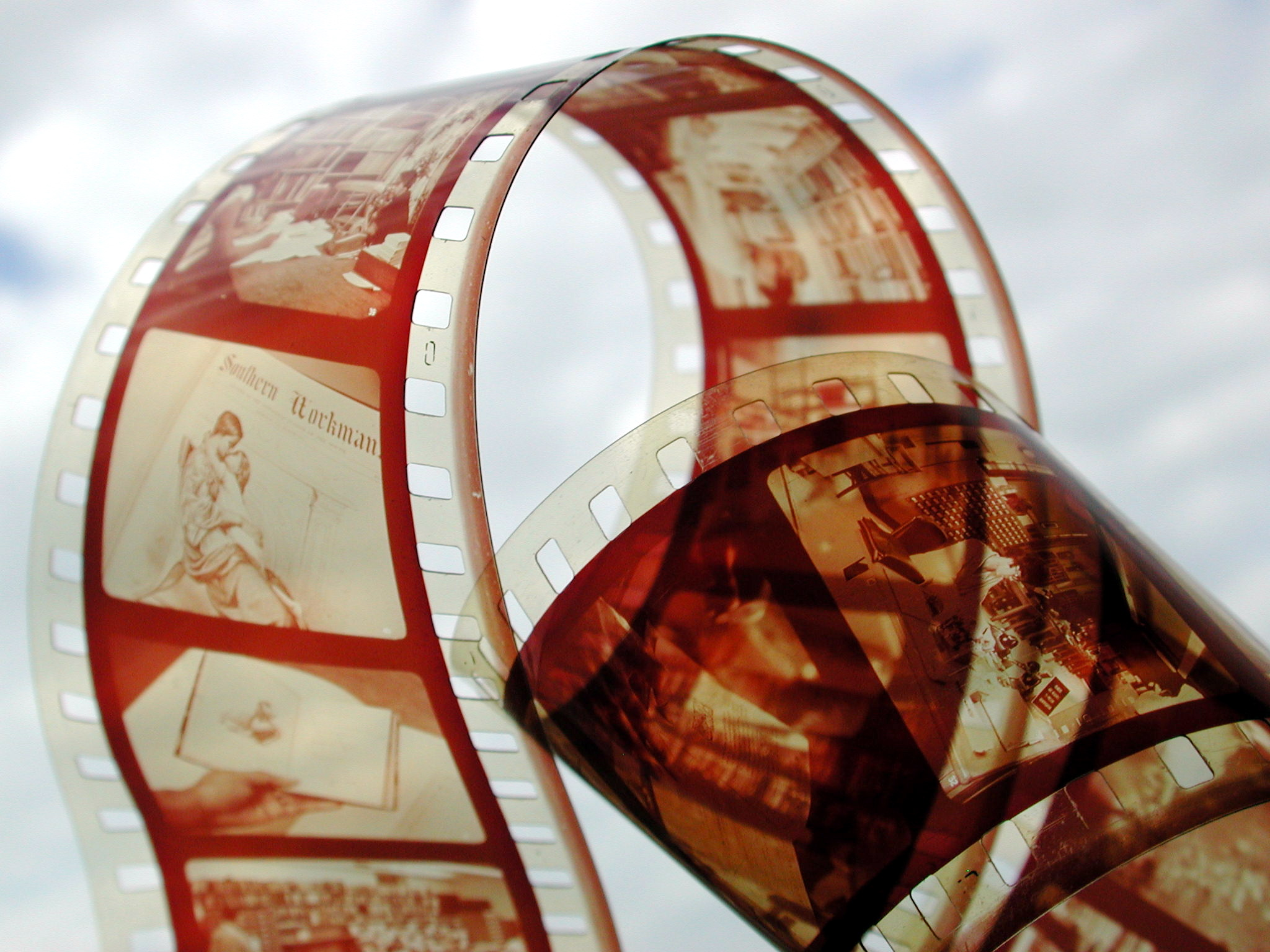 A twist of celluloid film. with actors visible on some frames