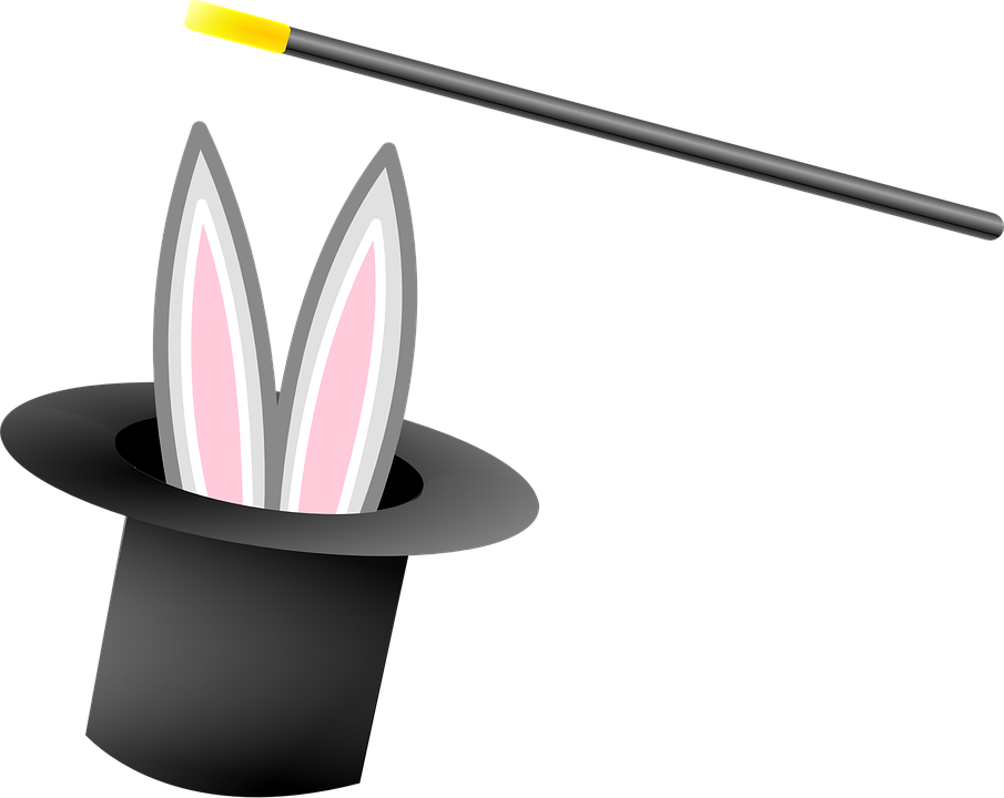 Magician's wand and rabbit appearing from hat